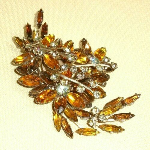 Vintage Round Ornate Gold-tone Brooch With Small Clear Rhinestones And Large Round Faceted Topaz Colored Center Stone