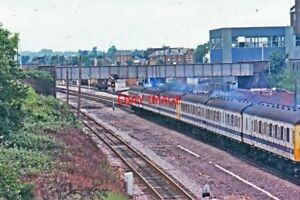 PHOTO-DMU-PASSING-NEWBURY-EAST-SIGNAL-BOX-1977