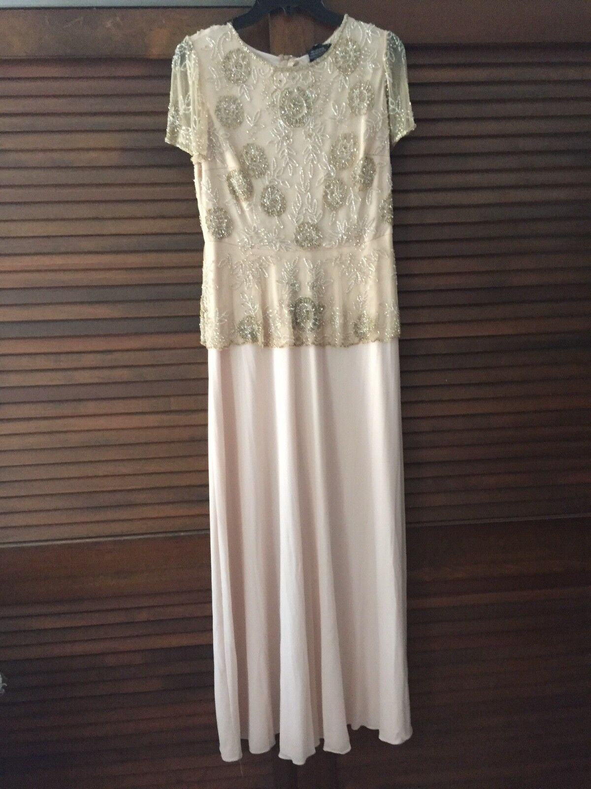 Mother of the Bride dress. Worn once. Size 6. Wrinkle free. Beautiful beading