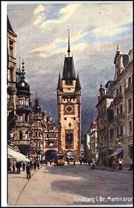 FREIBURG-Breisgau-um-1910-20-Wiedemann-Kuenstlerkarte-WIRO-Tram-am-Martinstor