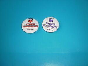 2 badges transformers autobot et decepticon vintage