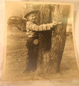 vintage-photo-young-boy-shooting-gun-holster-outfit