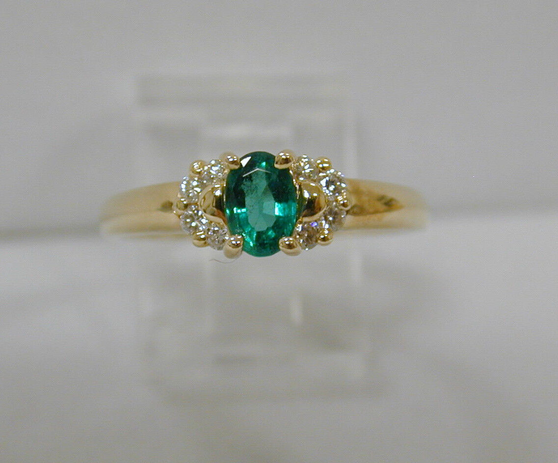 .52 CT OVAL EMERALD SOLITAIRE w .24 CT DIAMOND RINGSIZE 8 1 2HIGH QUALITY