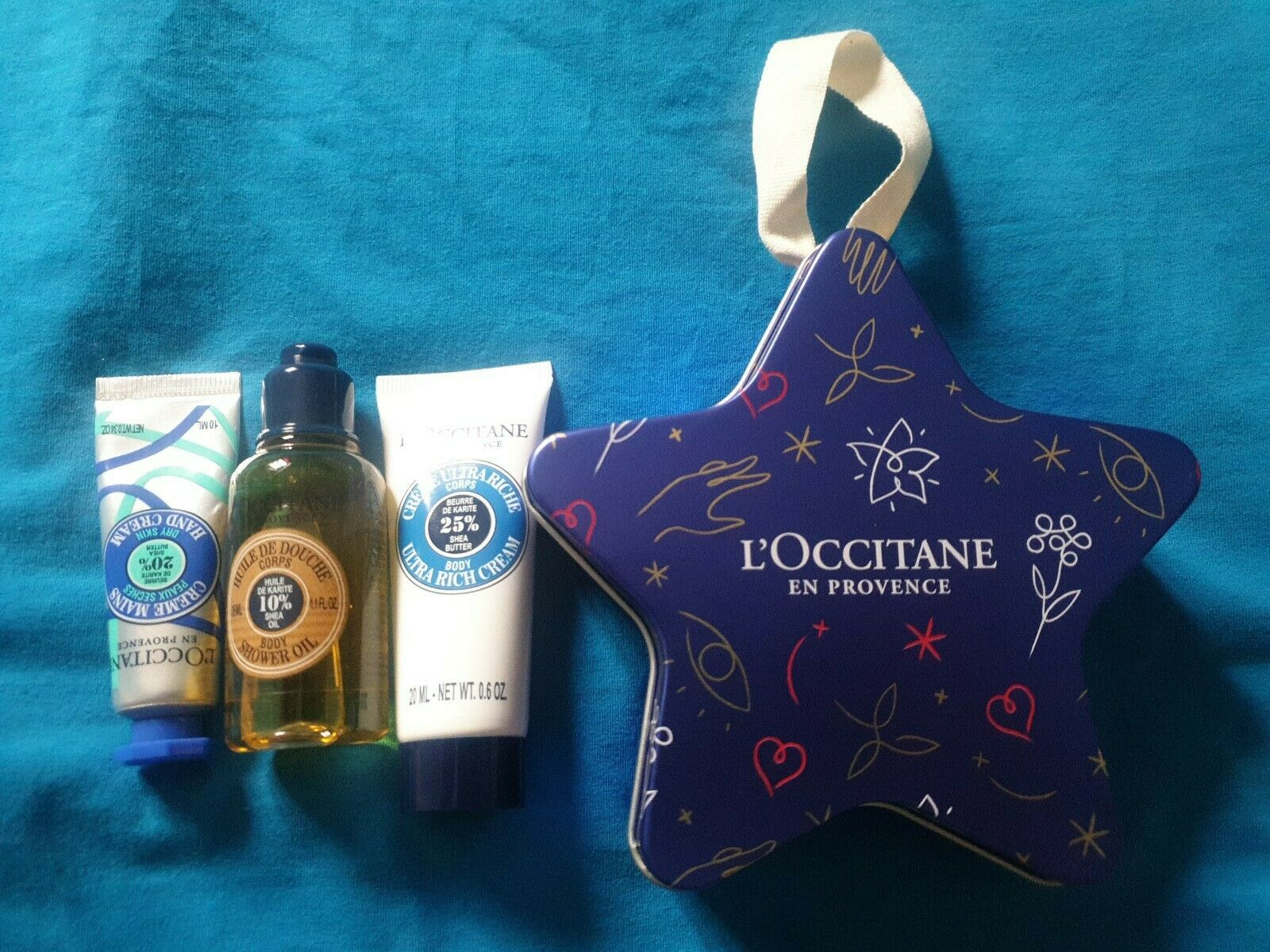 L'OCCITANE Blue Star Shaped Tin Christmas Tree Hanger Decoration with products