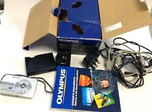 Olympus Mju 700 todo tipo de clima y reparaciones de repuestos de cámara Cargador folletos en caja