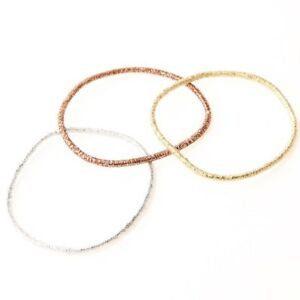 MOMA gorgeous Japanese MUJI rare hair rubber band gold silver bronz ... 87d76d77a4a