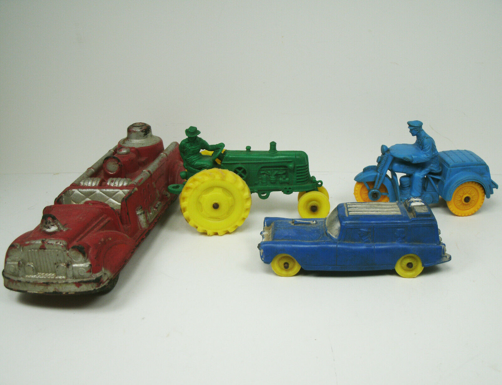 Auburn Rubber Fire Truck Station Wagon Green Yellow Tractor and bluee Yellow Moto