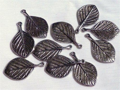 25x15mm C114...PACK OF 20 CHARMS SINGLE LEAVES SILVER PLATED