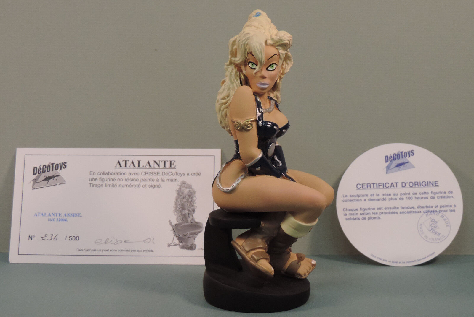 Atalante assise statue resine Decotoys 22004 numerede signe