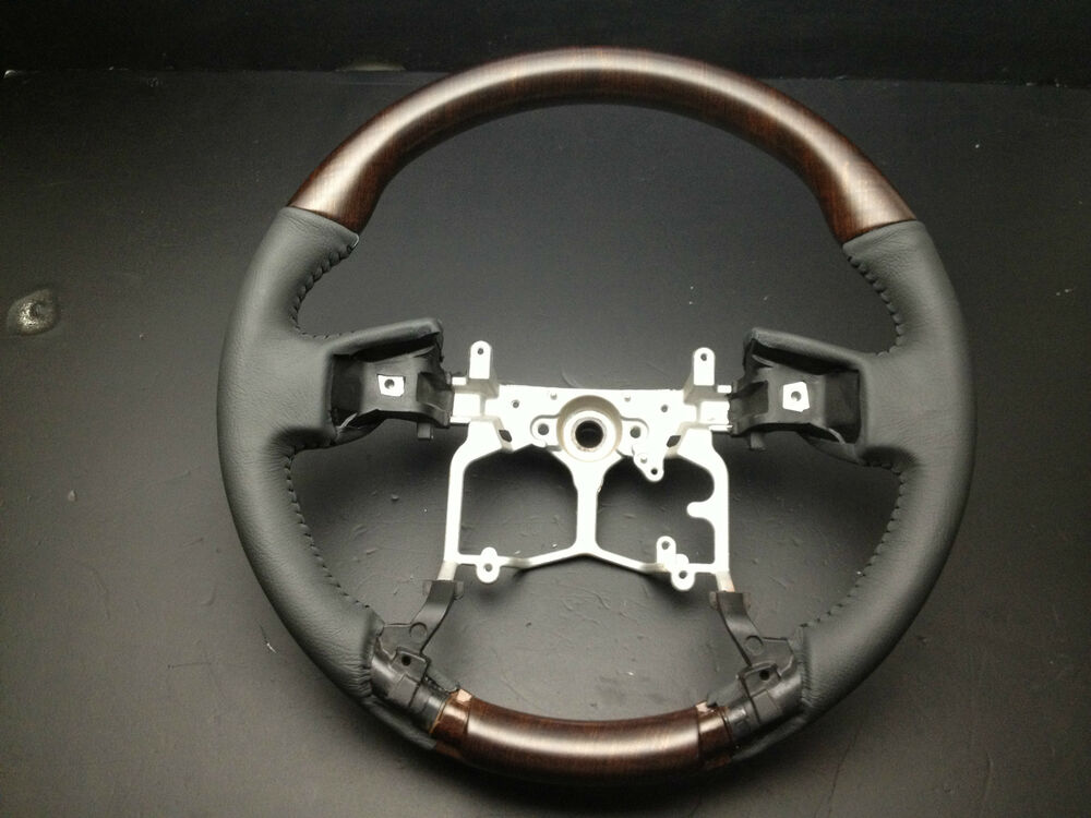 mit toyota tacoma 2012 2017 wood look genuine black leather steering wheel ebay. Black Bedroom Furniture Sets. Home Design Ideas