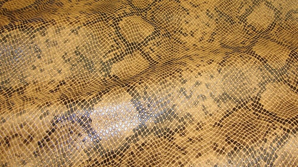 Vinyl upholstery fabric faux leather 54 quot wide caramel python metallic