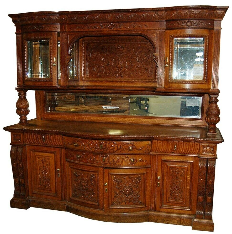 Heavily carved antique oak sideboard with curio top
