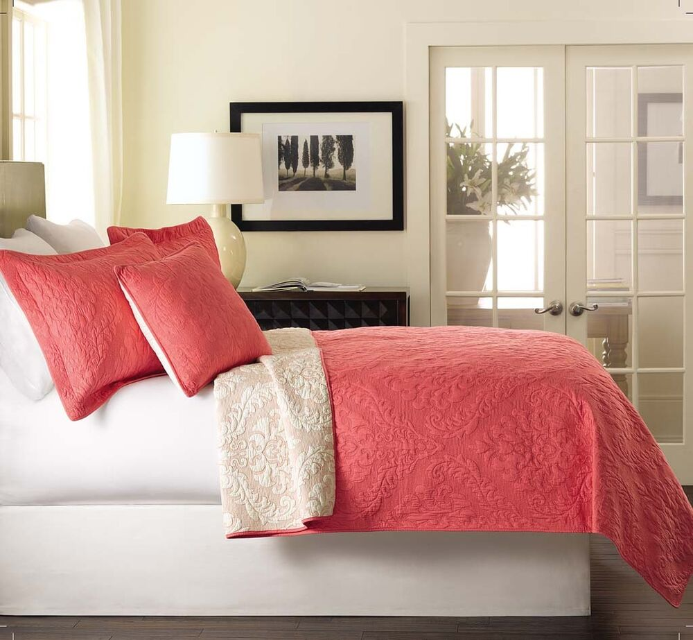 The four-piece Lily Coral Pink Comforter Bed Set includes a comforter, two shams, and one decorative square pillow. Beautifully enhanced with scrolling medallions, this bedding looks simple, yet so elegant. Made of cotton chenille, the comforter and shams have a timeless appeal. The comforter has.
