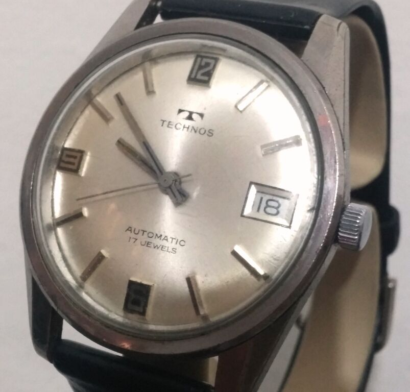 Vintage swiss technos automatic date fnf 905 17j steel silver men 39 s watch ebay for Technos watches