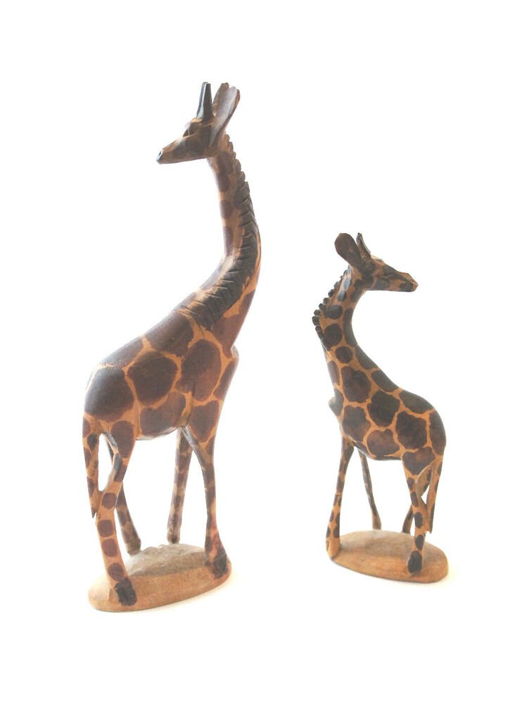 Two hand carved wooden giraffes made in kenya adorable