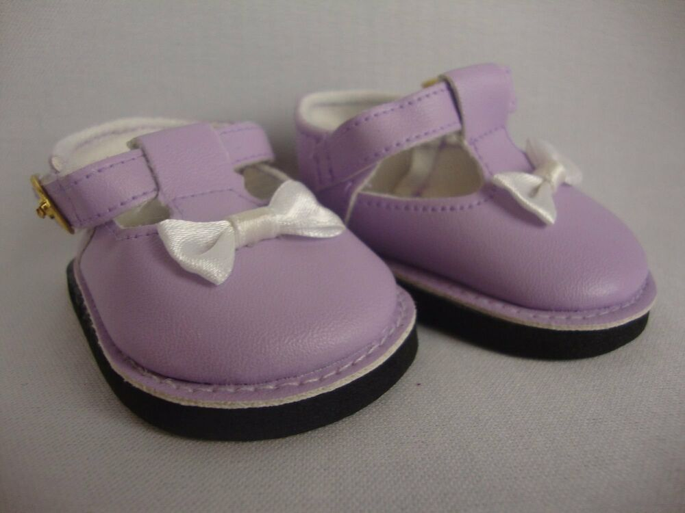 pair of purple dress shoes with white bow for 18 inch