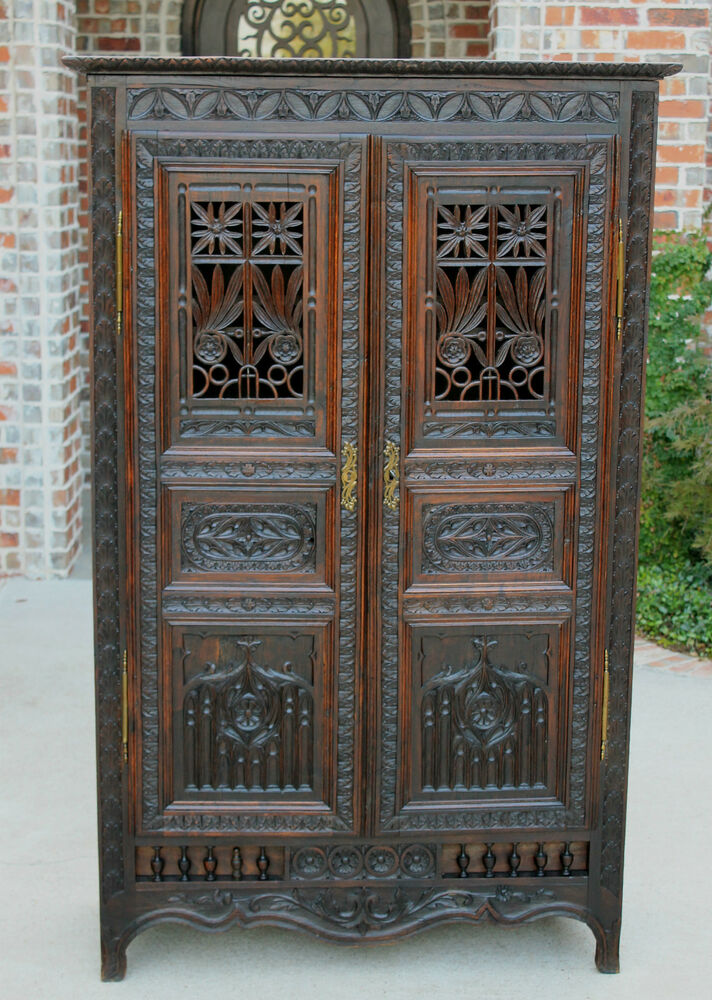 Antique french highly carved oak gothic cabinet cupboard