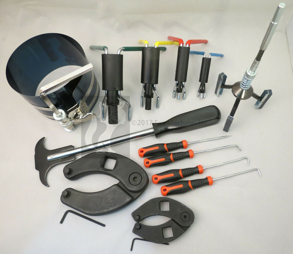 Hydraulic cylinder repair tool kit for skid steers