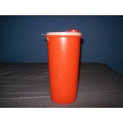 Kyпить TUPPERWARE ORANGE ROUND CANISTER CONTAINER WITH FLIP TOP LID GOOD CONDITION на еВаy.соm