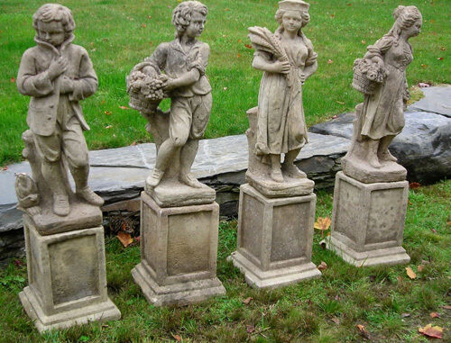 Antique english cast stone garden statues depicting the