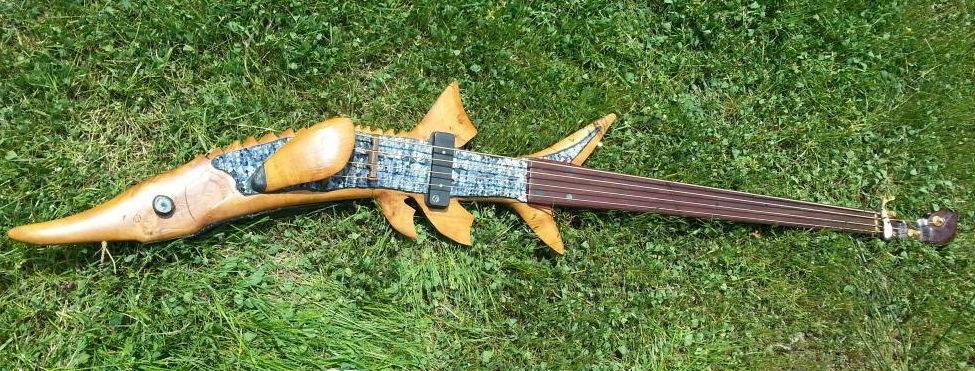 Custom hand carved sturgeon bass guitar signed by les