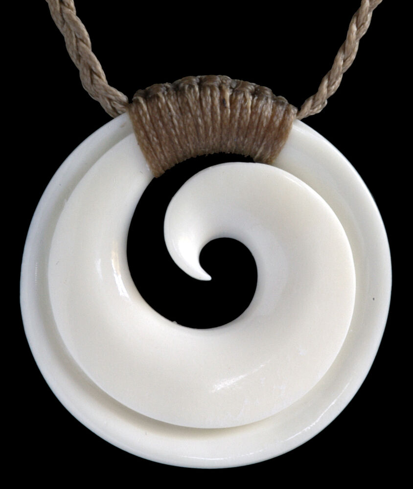 Hand carved bound maori koru bone carving pendant from new