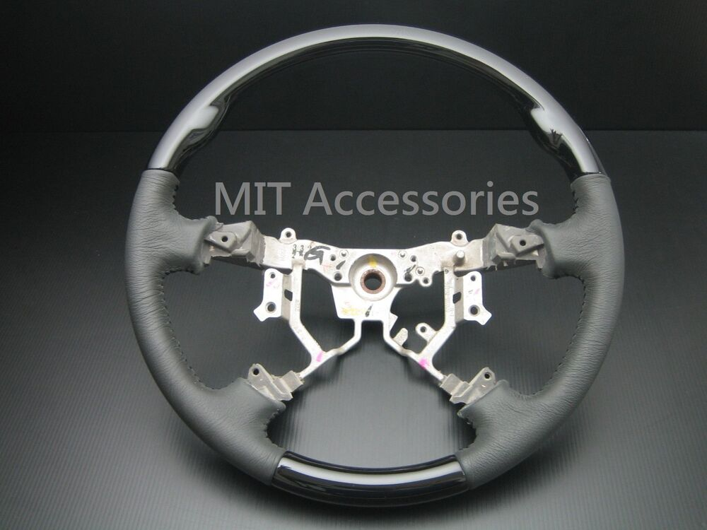 mit toyota tacoma 2004 2011 black piano wood leather steering wheel standard ebay. Black Bedroom Furniture Sets. Home Design Ideas