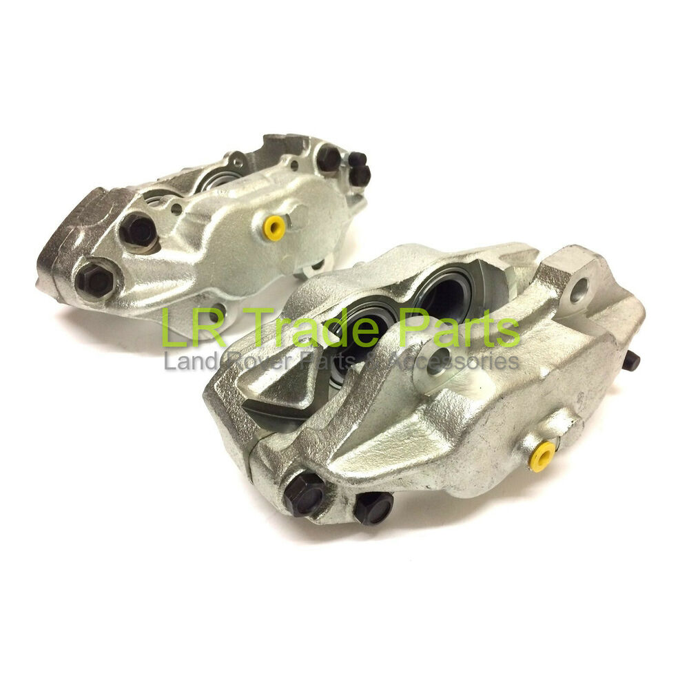 LAND ROVER DEFENDER NEW FRONT BRAKE CALIPERS X2 SOLID