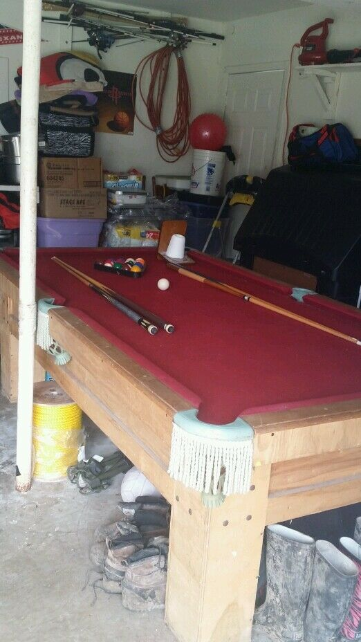 Billiards Table With A Set Of Four Sticks Chalk And Stand
