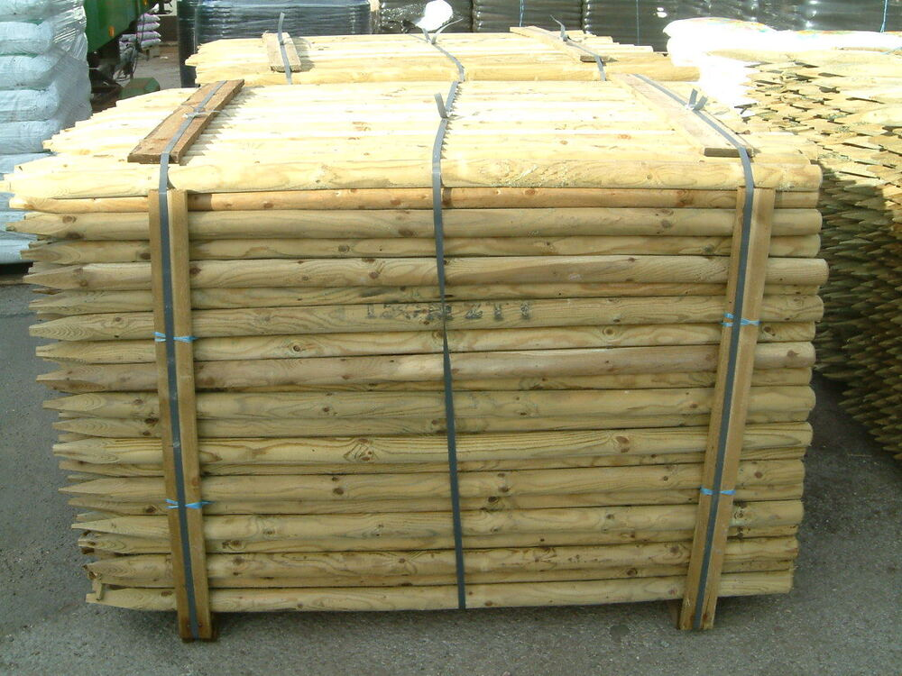 M ft round pointed wooden timber fence posts