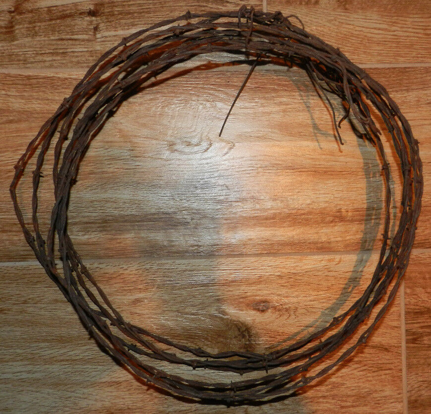 Vintage antique foot piece of barbed wire barb
