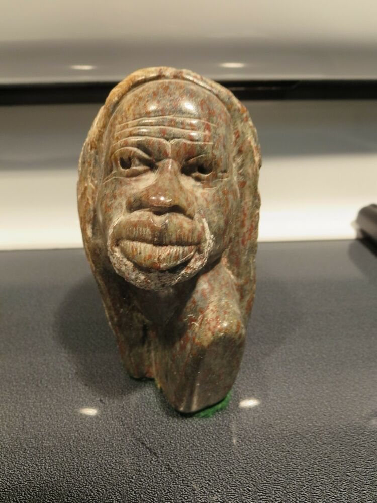 Primitive african soap stone carving man s head