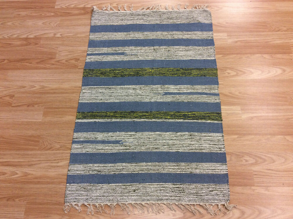blue striped rag rugs give