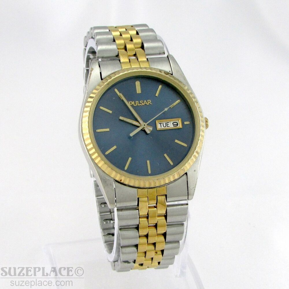 Pulsar two tone bilingual spanish mens watch day date wr 1 jewel new battery ebay for Watches of spain