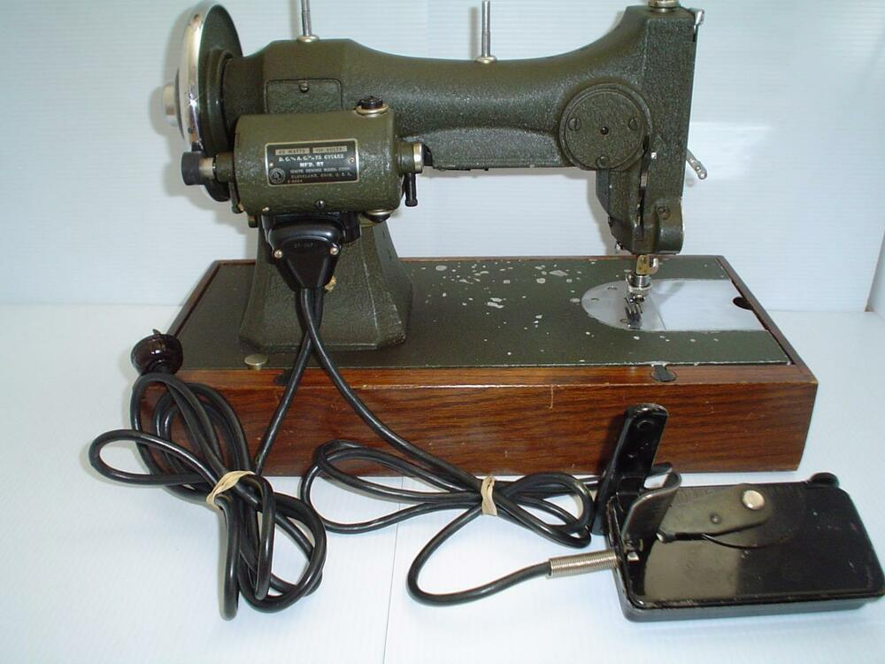 Electrical Sewing Machine : Vintage white rotary electric sewing machine with foot