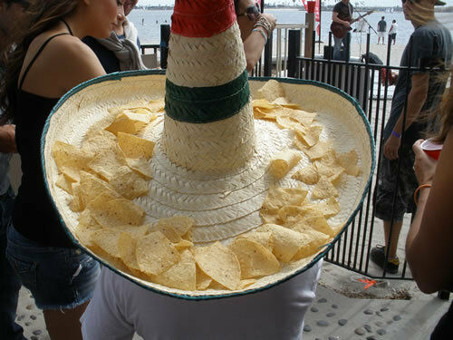 Midget with chips in hat