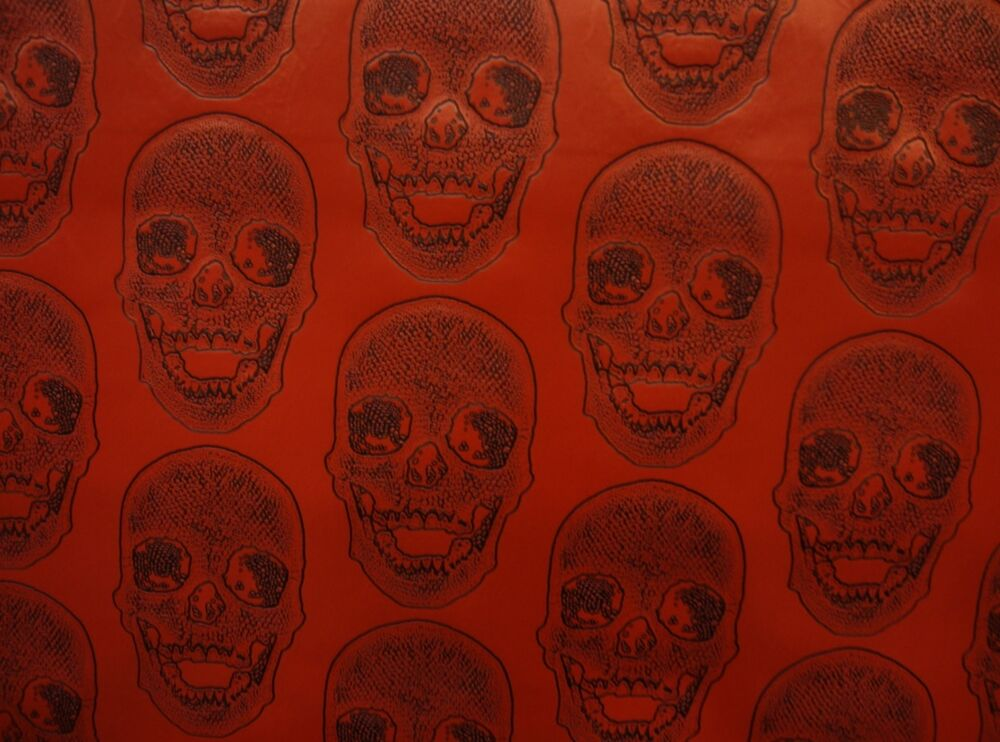 Vinyl faux leather upholstery black skull on red vinyl for Red leather fabric