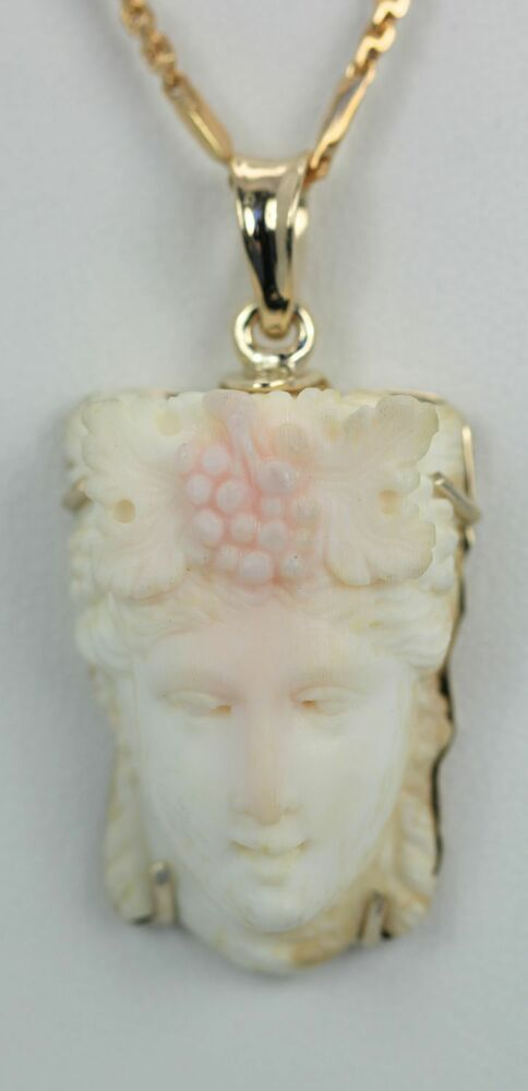 Angel skin coral exquisite carving of womens face circa