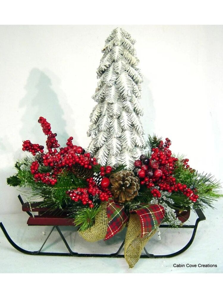 Woodland sleigh holiday centerpiece floral arrangement
