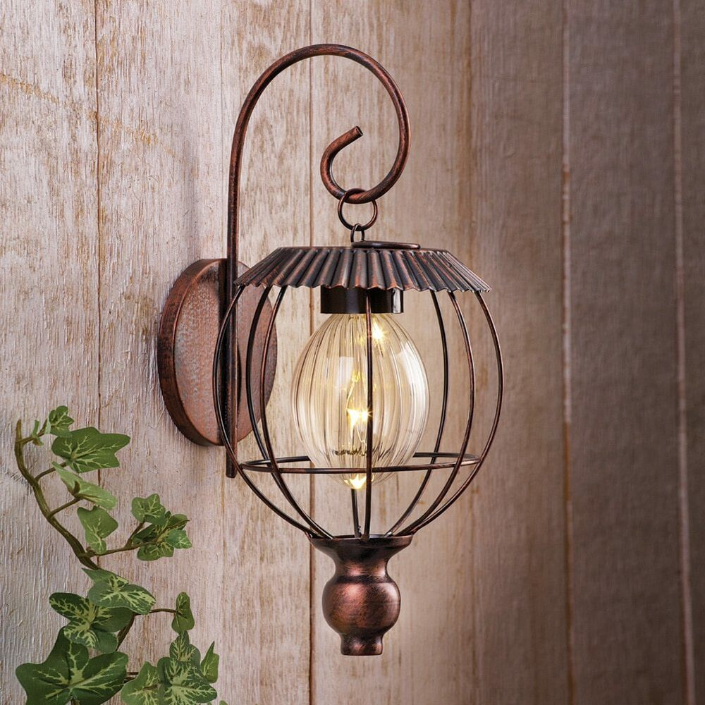solar powered decorative lanterns solar powered lighted rustic scroll wall lantern shed 5594