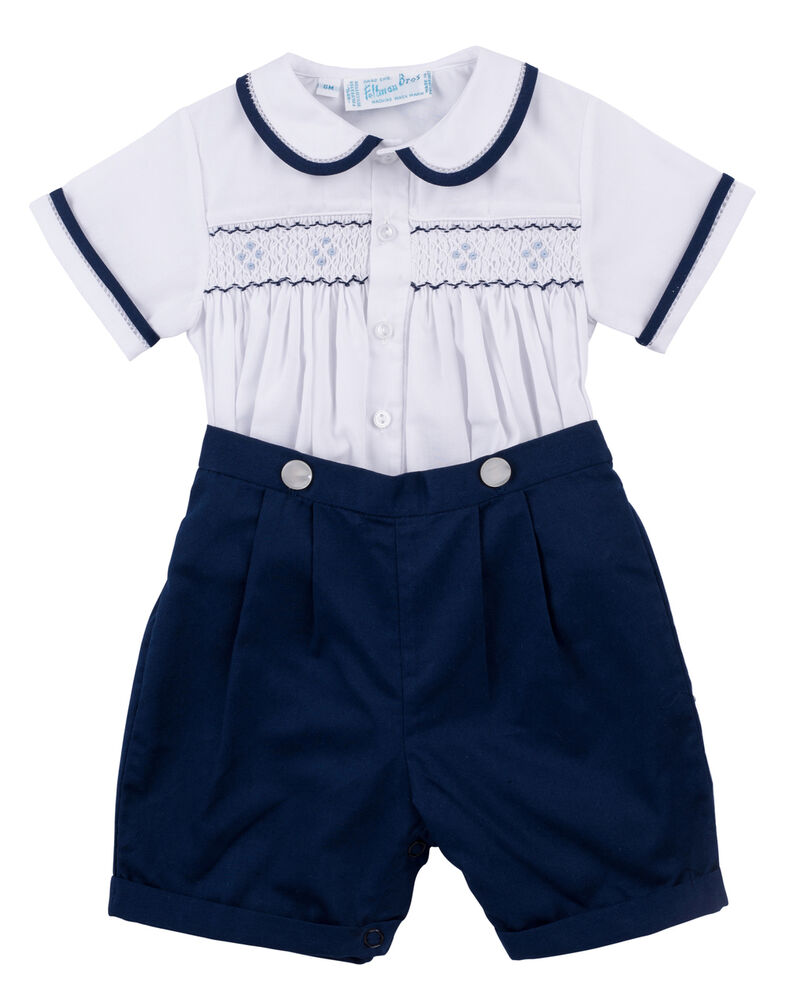 1st Birthday-Navy and Gold Glitter Baby Bodysuit Not all baby bodysuits are created equal – this popular style is a must-have for your precious little bundle. The neckband is designed for easy on-and-off and a three-snap closure makes diaper changes a cinch.