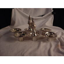 6 Silver plate Candle holder inserts and 4 Flame inserts