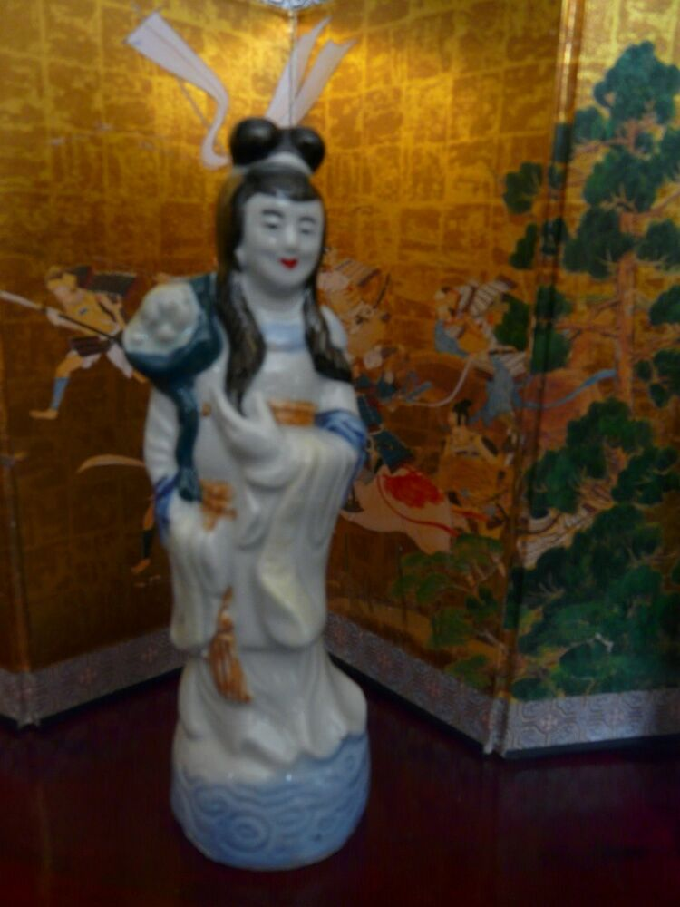 small porcelain geisha figurine