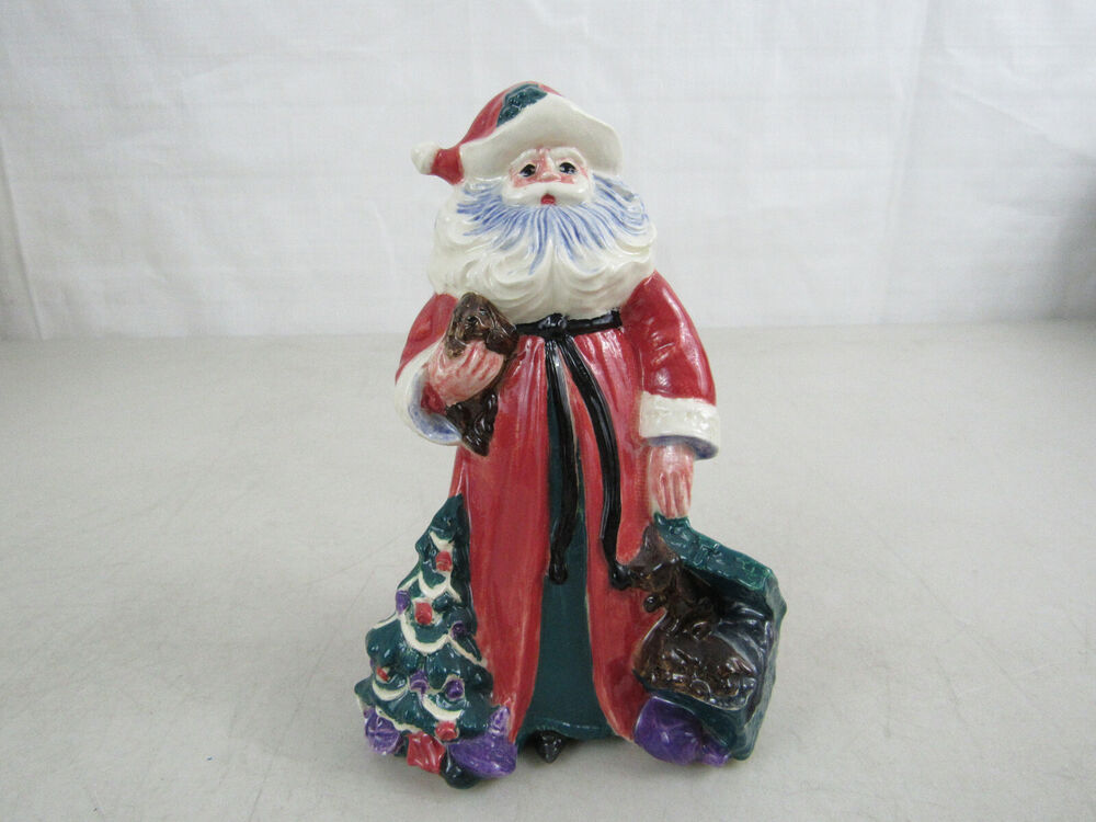 Collectible porcelain handpainted santa figurine with