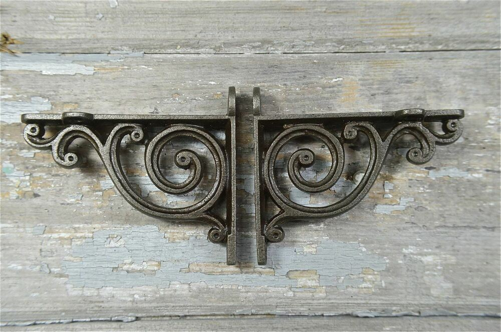 A PAIR OF SMALL VICTORIAN STYLE SCROLL BRACKETS CAST IRON