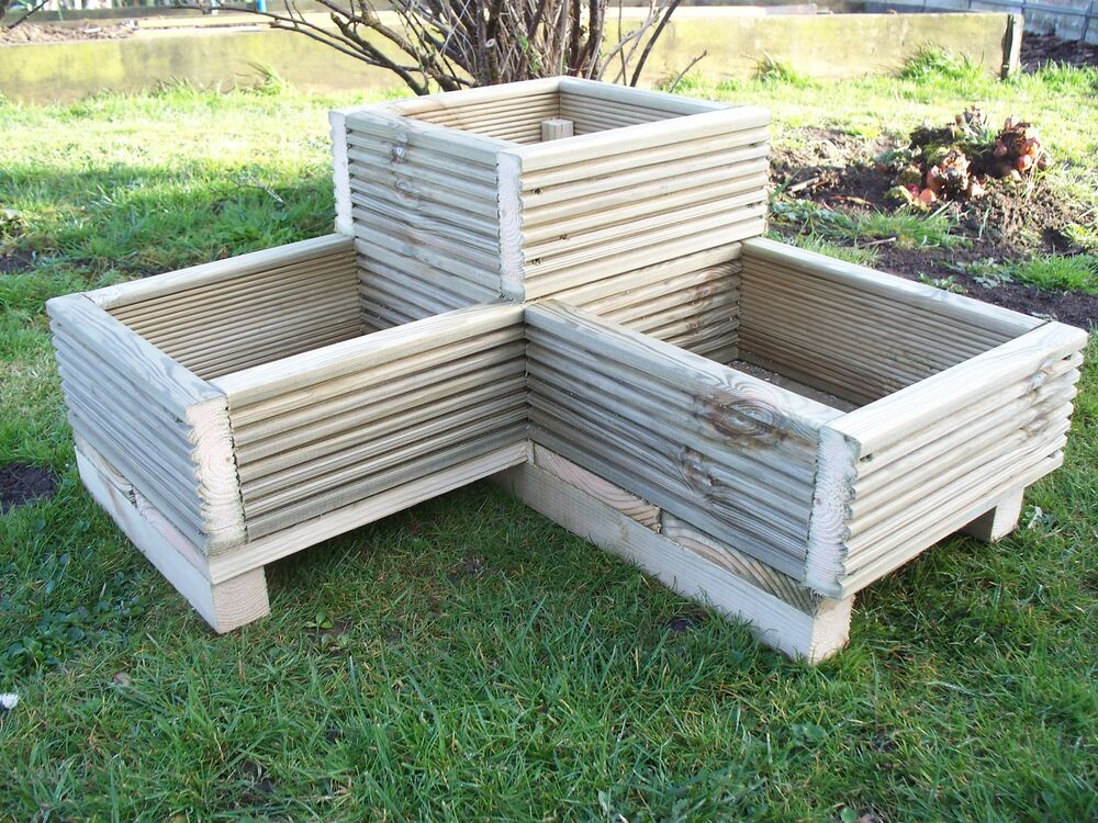 Corner decking wooden garden planter wood trough l shaped for Images of garden decking