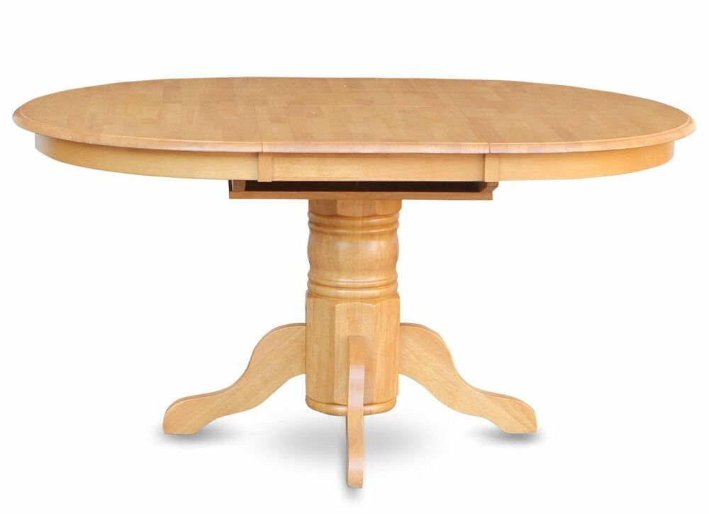 Avon 42x60 round to oval pedestal kitchen dining table for Solid wood round dining table with leaf