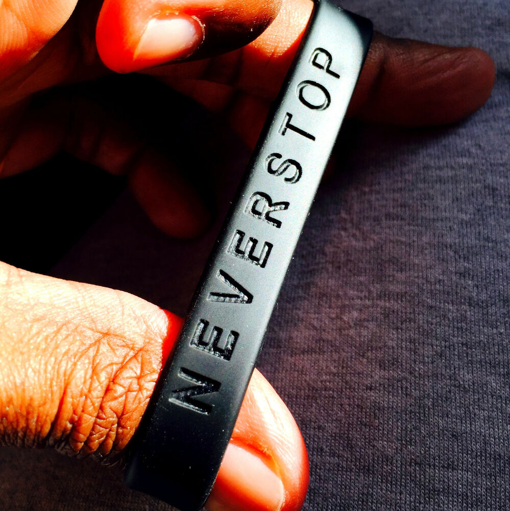 Never Stop  Band Silicone Rubber Bracelet Wristbandult Size Brand New
