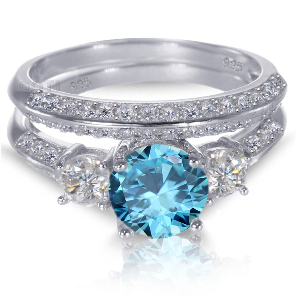 White gold sterling silver brilliant blue topaz wedding for Blue topaz wedding ring sets