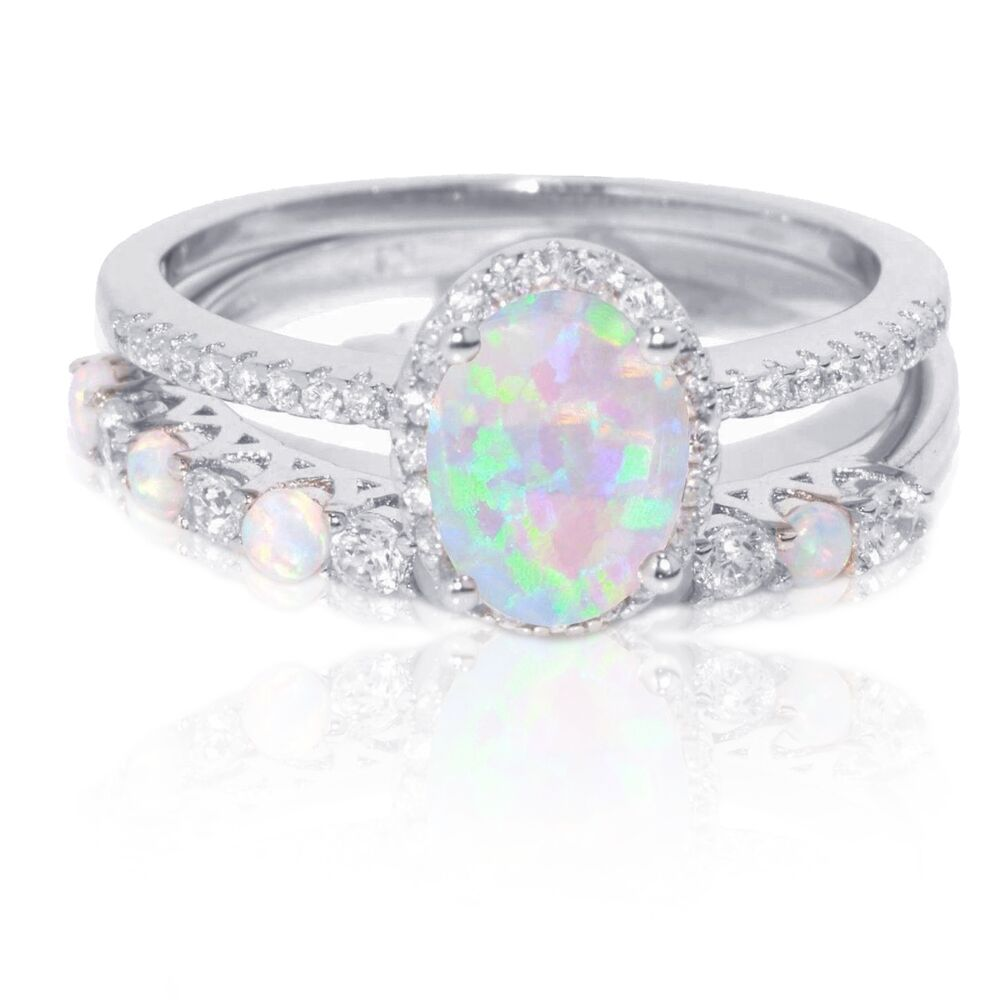 Opal Engagement Rings: Oval White Fire Opal Thin Simulated Diamond Engagement